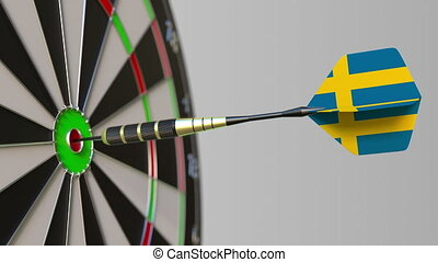 Dart featuring flag of Sweden hits bullseye of the target....