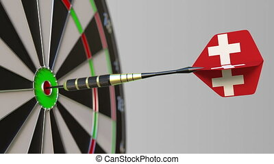 Dart featuring flag of Switzerland hits bullseye of the...