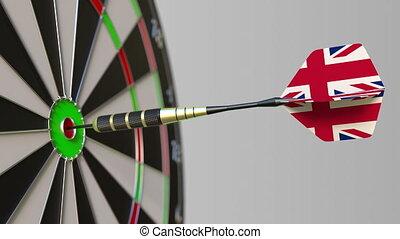 Dart featuring flag of the United Kingdom hits bullseye of...