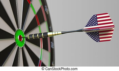 Dart featuring flag of the USA hits bullseye of the target....