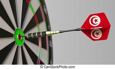 Dart featuring flag of Tunisia hits bullseye of the target....