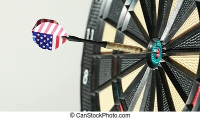 Dart hit directly into bulls eye, close up, side view