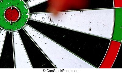 Dart hitting a bulls eye in slow motion