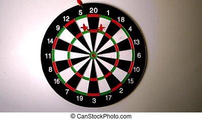 Dart hitting the dart board between