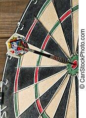 dart pin hit the bullseye on the dart