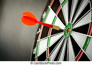 Dart - Right on target concept using dart in the bullseye on...