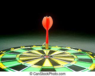 dartboard darts arrows in the target
