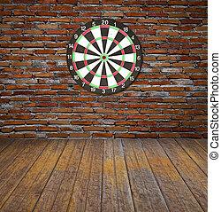 Dartboard on brick wall (Darts Hit Target)