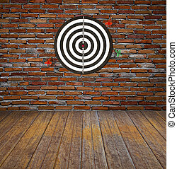 Dartboard on brick wall (miss darts)