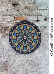 dartboard on old wall