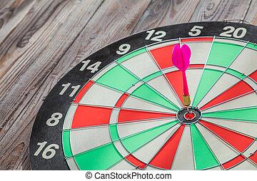 Dartboard on wood wall (Darts Hit Target)
