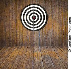 Dartboard on wood wall