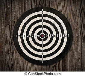 Dartboard on wooden wall, clipping path.