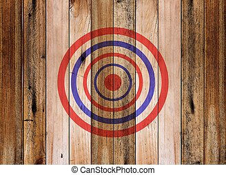 Dartboard target on old wooden wall