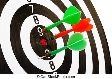 Dartboard with arrow in centre