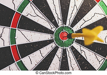 Darts arrow in the target center business goal concept