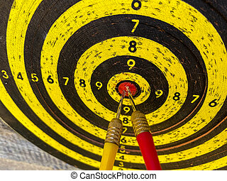 Darts board with arrows hitting the center target, focuses on success, planning to be smart concept