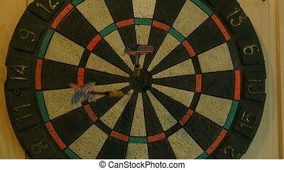 Darts hit the target, darts game, slow motion