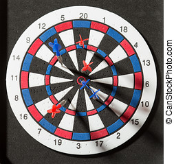 Darts hit dartboard - Red and blue darts hit dartboard