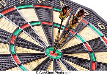 darts in dartboard on white background