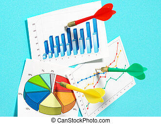 Darts sticking in graphs on blue background.