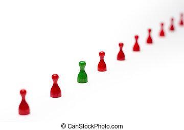 Das Bild zeigt Spielfiguren unterschiedlicher Farben. The ...
