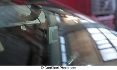 Dash cam recorder view through the car windshield camera movement