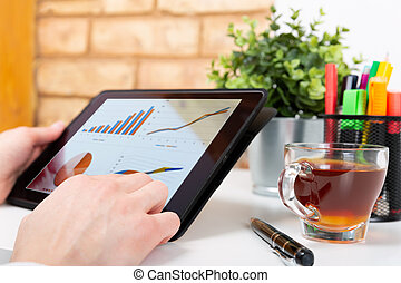 Data analysis concept shown on a tablet held by a woman
