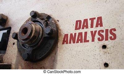 Data analysis conceptual metaphor - Machine wheels rotating...