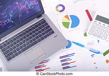 Data analysis - workplace with business graphs and charts, laptop and calculator