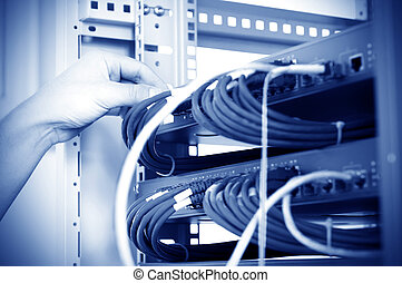 Data center servers and fiber optic cable - hand with fiber...