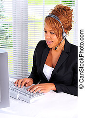 Data Entry - Pretty Young Woman Using A Computer In A Call...
