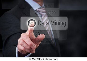 Data Mining - A businessman Pointing to a data mining button...