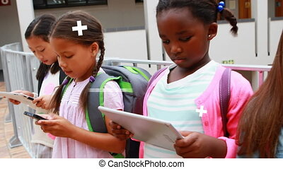 Animation of data processing over schoolchildren using digital tablets and smartphones at school. Global online network digital interface technology concept digitally generated image.