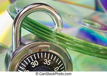 Padlock securing data or media discs.