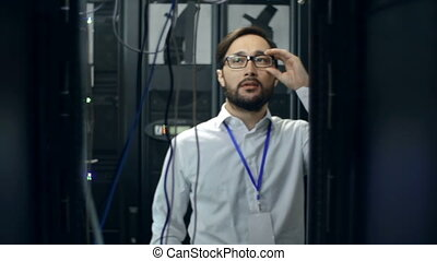 Data Storage Room Inspection - Man and woman measuring...