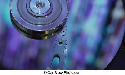 Data transfer. Hard disk with blue reflection