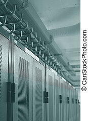Datacenter racks - a row of server racks in a datacenter ...