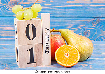 Date 1 January on calendar and fresh fruits, new years resolutions of healthy nutrition concept