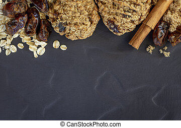 Date and Oatmeal Cookies and Ingredients Flat Lay Top View on Slate