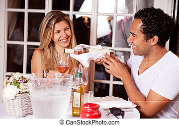 Date in a Cafe - A happy couple on a date to an outdoor...