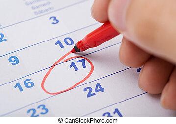 date, marquer, 17ème, calendrier, main