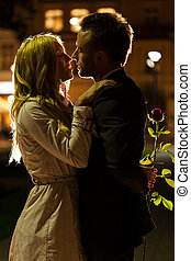 Date night kiss - A good-looking couple about to kiss on a ...