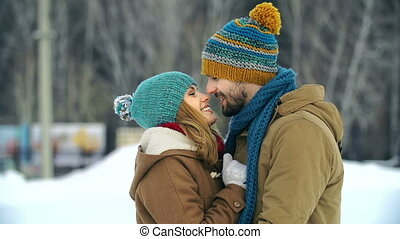 Date Outdoors - Close up of young couple cuddling standing...