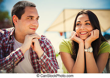 date - young couple on first date, outdoor shot summer day
