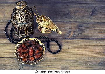 Dates, arabian lantern and rosary. Ramadan decoration -...