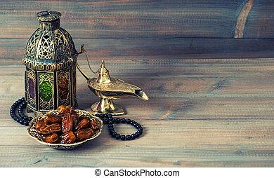 Dates, arabian lantern and rosary. Islamic holidays concept....