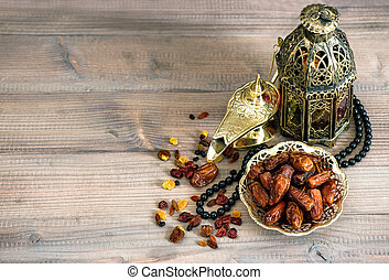 Dates, arabic lamps and rosary. Islamic holidays decoration...