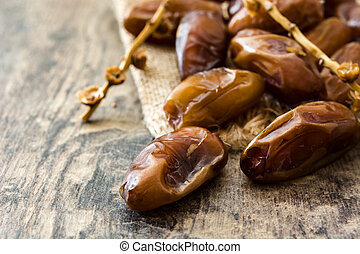 dates food on wooden table.
