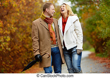 Dates in park - Portrait of ecstatic couple during walk in...